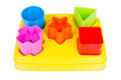 Juguete del clasificador de la forma con los diversos bloques coloreados aislados Imágenes de archivo libres de regalías