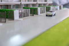 Juguete del coche en el camino Imagen de archivo