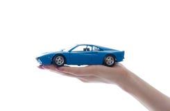 Juguete del coche en la palma Fotos de archivo libres de regalías