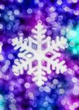 Juguete del copo de nieve en fondo colorido Imagenes de archivo
