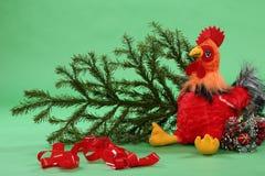 Juguete del gallo con la rama spruce Imágenes de archivo libres de regalías