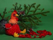 Juguete del gallo con la rama spruce Imagen de archivo libre de regalías