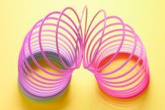 Juguete del muelle en espiral Fotos de archivo libres de regalías