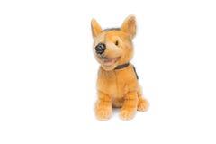 Juguete del perro de la muñeca para los niños En un fondo blanco Imagenes de archivo