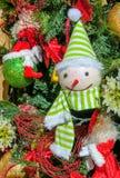 Juguete divertido de la Navidad Muñeco de nieve en abeto Imagen de archivo libre de regalías