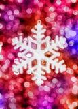 Juguete grande del copo de nieve en fondo colorido Fotografía de archivo libre de regalías