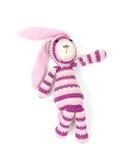 Juguete hecho punto divertido del conejo que muestra la dirección correcta Fotos de archivo libres de regalías