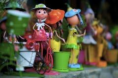Juguete lindo de la lata - muchacha en una bici foto de archivo libre de regalías