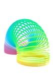 Juguete multicolor del resorte aislado en blanco Foto de archivo