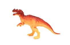 Juguete plástico anaranjado del dinosaurio de la vista lateral Imagen de archivo