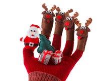 Juguete Santa Claus del concepto de la Navidad y reno con los regalos a mano Fotografía de archivo