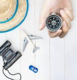 Juguete y accesorios que viajan del niño con el compás Imagen de archivo libre de regalías