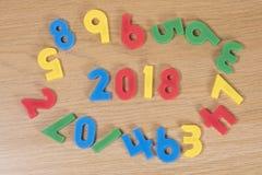 Juguetes de aprendizaje coloridos y el año 2018 del número Imágenes de archivo libres de regalías