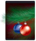 Juguetes de Cristmas en bransh del pino Imágenes de archivo libres de regalías
