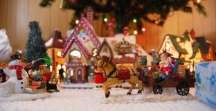 Juguetes de la aldea de la Navidad Fotografía de archivo