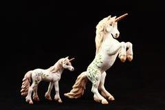 Juguetes de la estatuilla del unicornio Imagenes de archivo