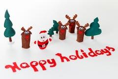 Juguetes de la Navidad del concepto Papá Noel con el árbol del reno y de abeto en nieve Foto de archivo libre de regalías
