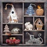 Juguetes de la Navidad en caja de madera del vintage Decoraciones de la Navidad del collage Foto de archivo libre de regalías