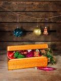 Juguetes de la Navidad en una caja vieja Fotografía de archivo libre de regalías
