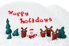 Juguetes de la Navidad Papá Noel con el árbol del reno y de abeto en nieve Fotografía de archivo