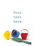 Juguetes de la salvadera con el espacio para el texto Foto de archivo libre de regalías