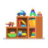 Juguetes de los niños en el estante de madera Imagenes de archivo