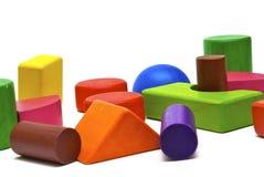 Juguetes de madera coloreados Fotografía de archivo
