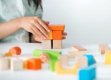 Juguetes de madera coloreados para el edificio Fotografía de archivo libre de regalías