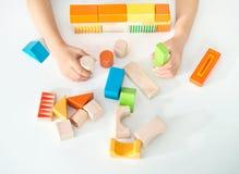 Juguetes de madera coloreados para el edificio Imágenes de archivo libres de regalías