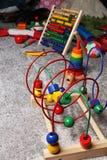 Juguetes de madera en el piso Imágenes de archivo libres de regalías