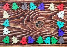 Juguetes de madera de la madera contrachapada en la tabla para el banquete de la Navidad Fotografía de archivo libre de regalías