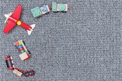 Juguetes de madera de los niños en la alfombra fotografía de archivo libre de regalías