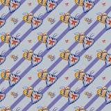 Juguetes del modelo bajo la forma de corazón en fondo azul Fotografía de archivo libre de regalías