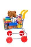 Juguetes en el carro de compras imagen de archivo libre de regalías