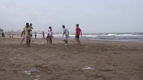 Juhu Beach. Youngsters playing football at Juhu Beach, in Bombay, Mumbai, India on July 30, 2016
