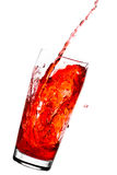 Juice. Red juice in glass with splashes - isolated on white Stock Photo