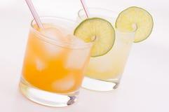 Juice. Two glasses of juice on white background Stock Photo