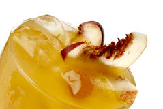 Juice. Fresh peach juice with ice and slice Stock Images