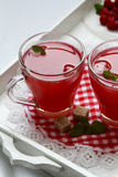 Juice. Raspberry juice flavored with mint Stock Images