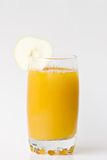 Juice. Glass in white background royalty free stock image