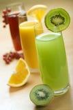Juice. Fresh natural kiwi juice in focus close up royalty free stock image