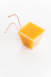 Juice. Orange juice in square glass with straws isolated Royalty Free Stock Photo