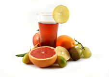 Juice. Fruit juice in glass with various fruits Stock Photography