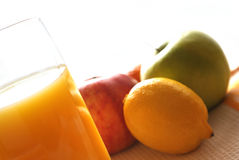 Juice. Fruit juice in glass with various fruits Royalty Free Stock Photography