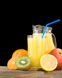 Juice And Oranges On Black Stock Images