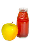 Juice and apple. Juice in a bottle and yellow apple Stock Photo