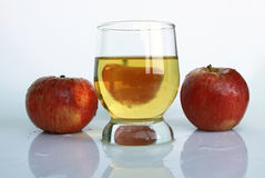 Juice and apples. Apple juice in a glass and red apples Royalty Free Stock Photo