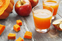 Juice of apples and pumpkins Royalty Free Stock Photo