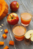 Juice of apples and pumpkins Royalty Free Stock Images