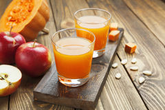 Juice of apples and pumpkins Stock Images